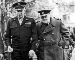 General Dwight D. (Ike) Eisenhower and Churchill having a walk, talk and smoke, Northern France, 1944.